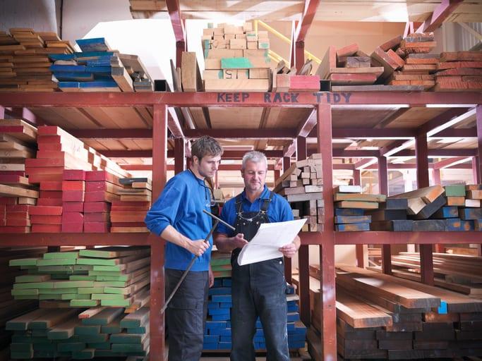 Oswald Wholesale Lumber Workers in wood store in joinery