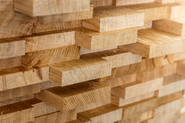 Oswald Wholesale Lumber Wood timber construction material for background and texture.